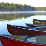 Canoes on Goldeye Lake landscape